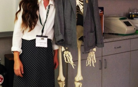 Science teacher Lauren Fieberg poses next to her life-sized human skeleton model.