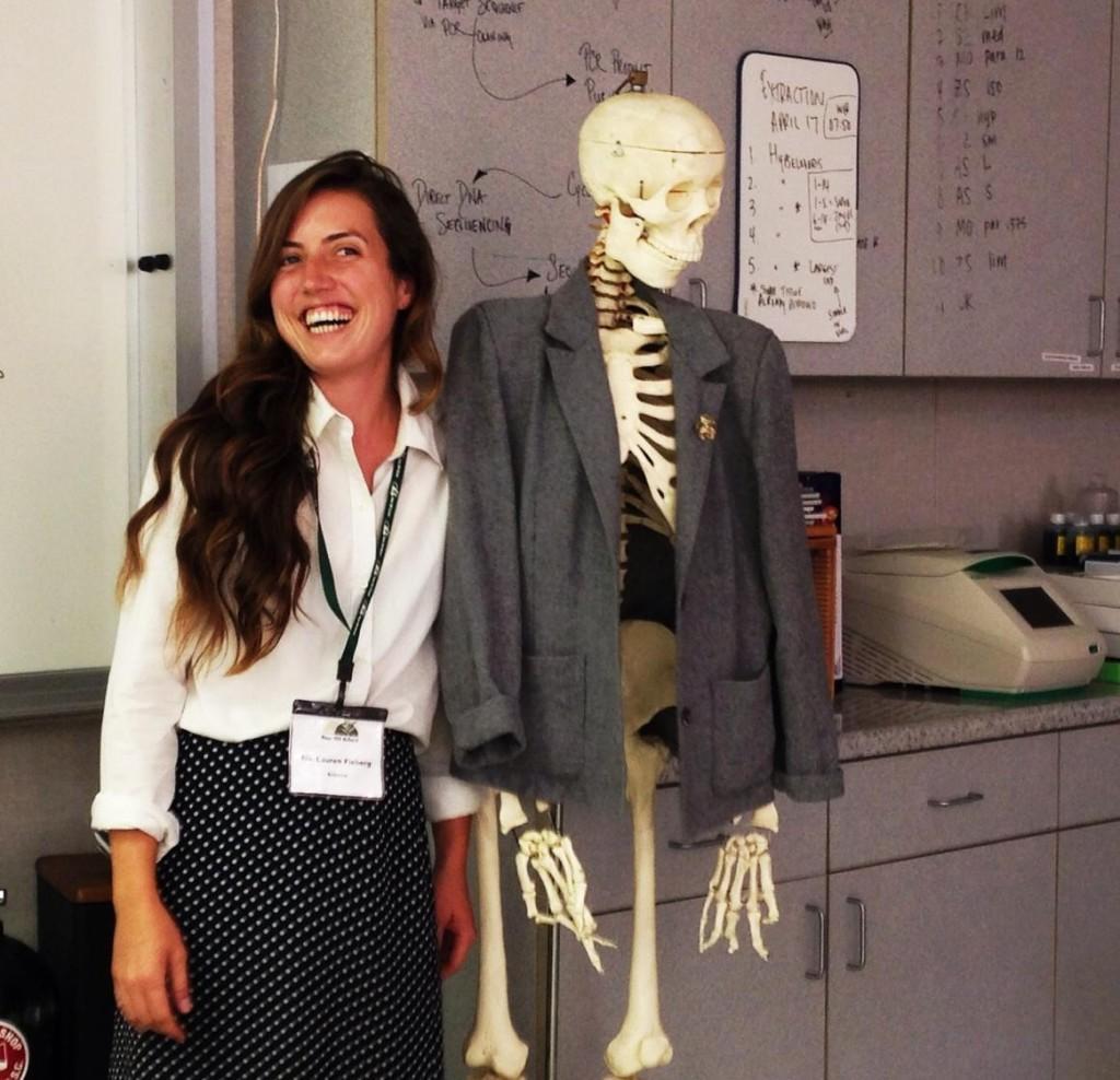 Science+teacher+Lauren+Fieberg+poses+next+to+her+life-sized+human+skeleton+model.
