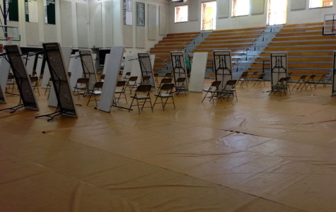 Tables and chairs being put away after the Sept. 18 Plan test for all sophomores in the Peter V. Ueberroth Gymnasium. September 18 2013.