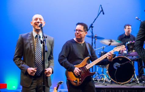 Mr. Irwin and Mr. Izurieta rock out during the Sgt. Pepper's Lonely Club band performance Friday October 25, 2013. Photographer: Kellen Ochi