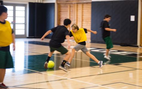 Sage Fit students play indoor soccer inside the Peter V. Ueberroth Gymnasium. October 11, 2013. Photographer: Kellen Ochi