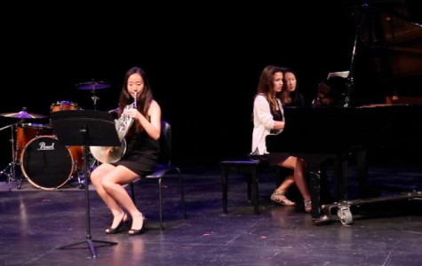 Sophomore Janis Jin plays the French Horn during her concert, accompanied by fellow sophomores Jaclyn Gerschultz and Sarah Yang. March 16 2014.