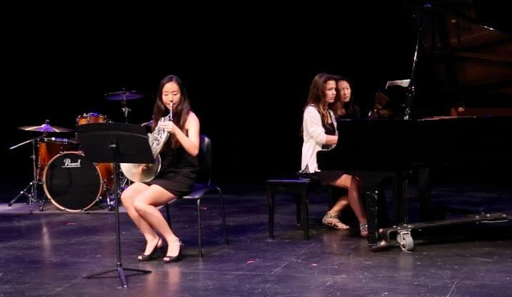 Sophomore+Janis+Jin+plays+the+French+Horn+during+her+concert%2C+accompanied+by+fellow+sophomores+Jaclyn+Gerschultz+and+Sarah+Yang.+March+16+2014.