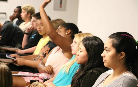 A new student asks a question about Sage during New Student Orientation in the Argyros Family Lecture Hall (MMLH) on Aug. 21.
