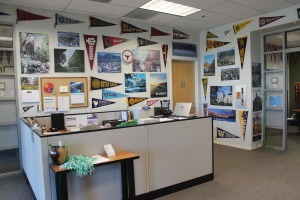 The College Counseling office is decorated with flags and posters from colleges around the world.