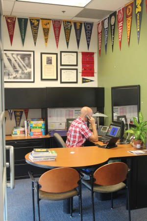 Andrew Losier, Associate Director of College Counseling, takes a phone call.