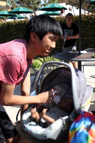 Junior Dan Lam tends to his baby.