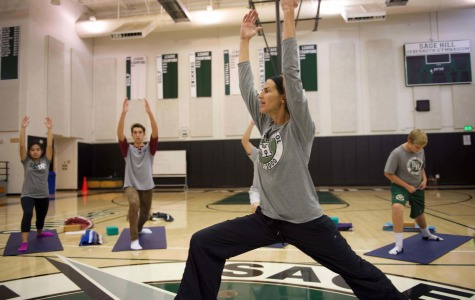 Connolly leads her students in a warrior pose stretch.