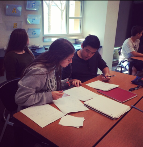 Students in Kelly May's Accelerated Precalculus class collaborate on an assignment.