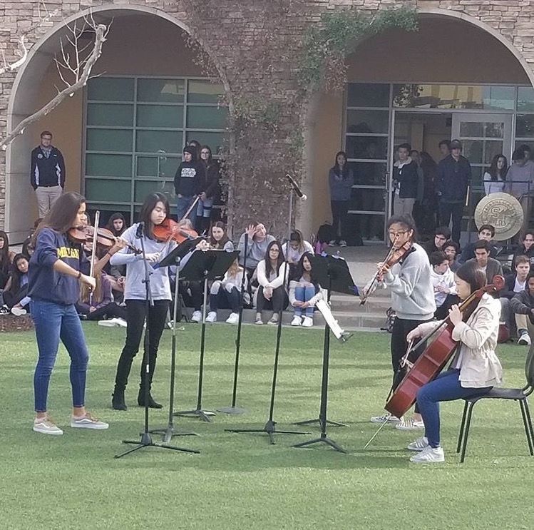 Students perform at Town Meeting in front of the school