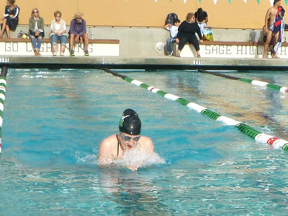 Nicole Harvey competes in a 100 yard breaststroke
