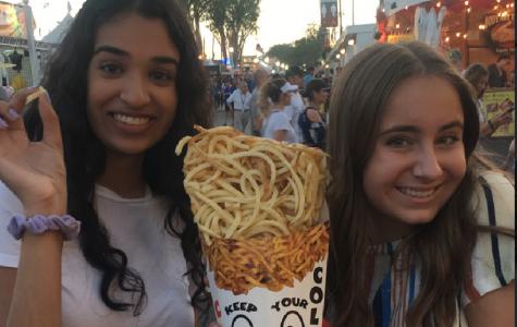 Seniors Ishani Patel and Miranda deBruyne share some of the famous OC Fair curly fries
