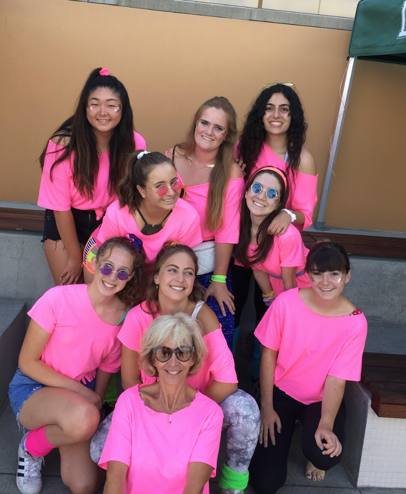 Madame Rouville's advisory dresses up for the retro themed senior pool party retreat
