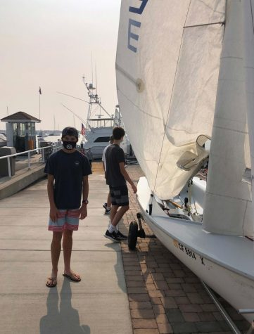 Sophomore Brooks Orradre and his sailing teammates prepare for sailing practice. Photo courtesy of Amber Orradre.