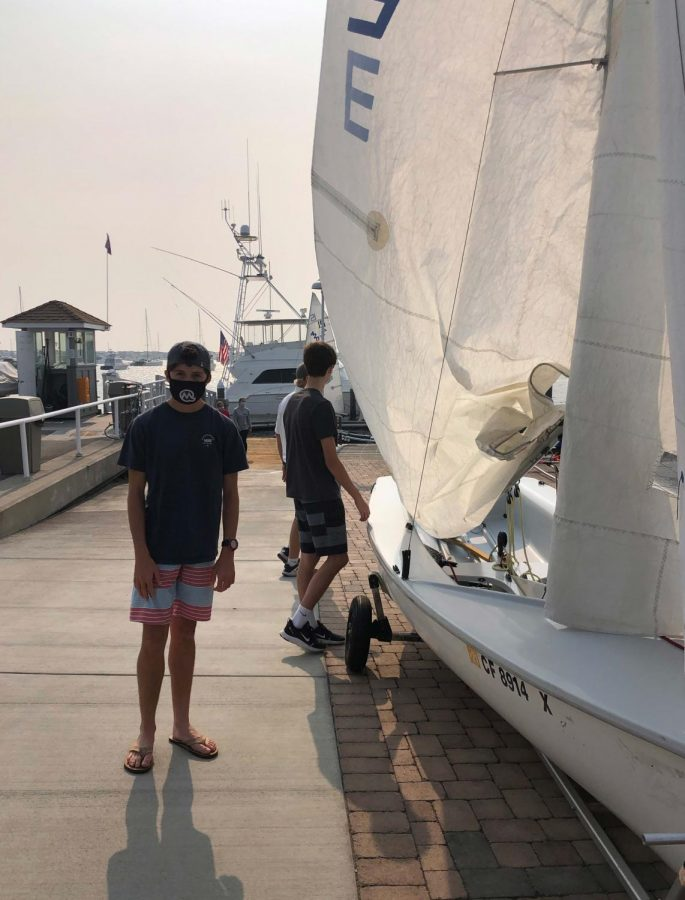 Sophomore+Brooks+Orradre+and+his+sailing+teammates+prepare+for+sailing+practice.+Photo+courtesy+of+Amber+Orradre.+