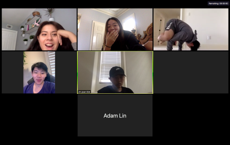 Members of the winning team cheer on their teammate Peter Huang as he attempts the crow pose.