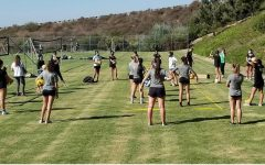 The girls' volleyball teams practice outside instead of on the indoor courts.