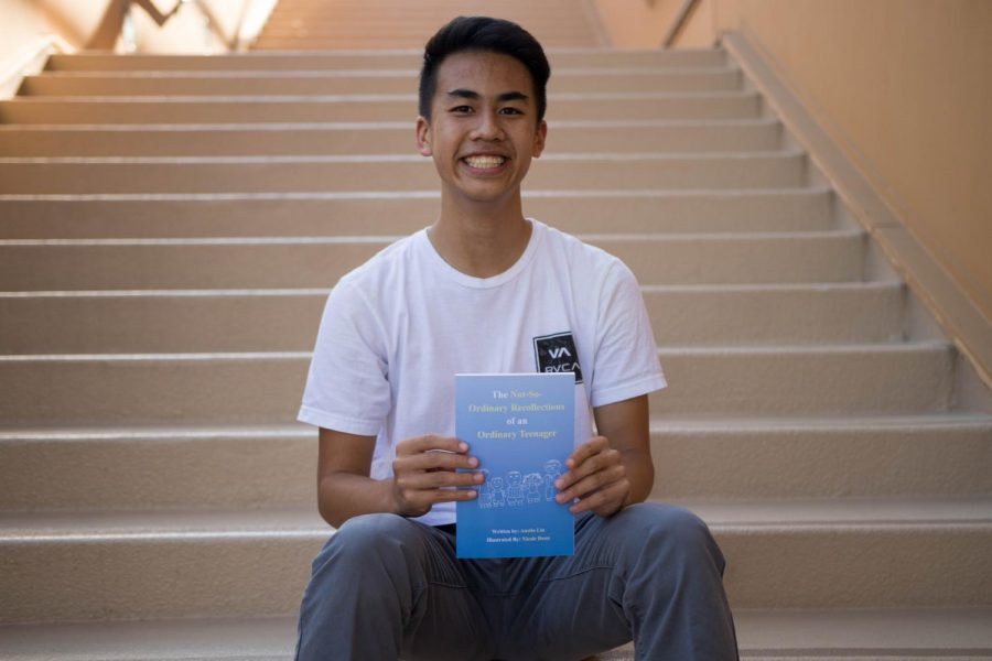 Senior Austin Lin holds up his newly published childrens book